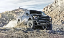 2017 Ford F-150 Raptor rides on gravel among the rocks